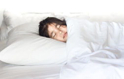 Asian girl sleeping on bed. Asian girl waking up on white pillow and bed refresh shop Royalty Free Stock Image