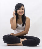 Asian girl with a smart phone Royalty Free Stock Image