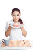 Asian girl smell strawberry cake and smile Royalty Free Stock Photography