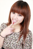 Asian girl smile. Beautiful Asian girl smiling on white Stock Photography