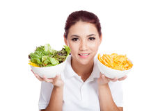 Asian girl smile with crisps and salad Royalty Free Stock Photography