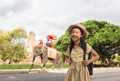 Asian girl smile happily,tourists on an ride elephant tour background,Ayutthaya,Thailand,summer vacation,travel concept. stock photo