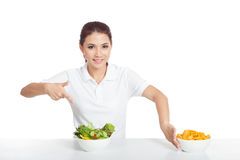 Asian girl smile point to salad push crisps away. Isolated on white background stock photo