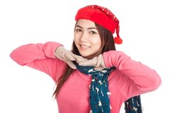 Asian girl smile with red christmas hat with both hands under ch Stock Image