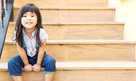 asian girl smile sitting on yellow stairs line Royalty Free Stock Photography