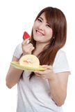 Asian girl smile with strawberry roll cake Royalty Free Stock Images