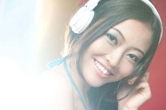 Asian girl smiling with headphones Stock Photography