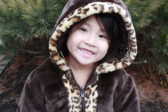 Asian girl smiling hood. Little asian chinese girl with leopard print coat and hood over her head Stock Photography
