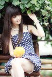 Asian girl smiling outdoor. Asian girl holding a melon smiling outdoor in summer Stock Photography