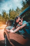 Asian girl smiling with perfect smile while sitting in the car. Royalty Free Stock Photography