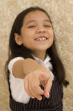 Asian Girl Smiling and Pointing Royalty Free Stock Photography