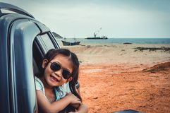 Asian girl smiling while sitting in the car. Travel on vacation royalty free stock image