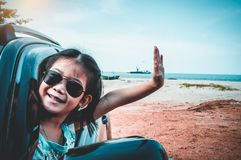 Asian girl smiling while sitting in the car. Travel on vacation royalty free stock photo