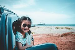 Asian girl smiling while sitting in the car. Travel on vacation stock photography