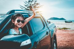 Asian girl smiling while sitting in the car. Travel on vacation stock photo
