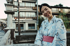 An asian girl smiling and wearing Yukata Stock Photography