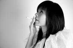 Asian girl smoking Stock Images