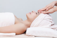 Asian girl in spa. Beautiful asian girl in spa on spa bed Royalty Free Stock Image