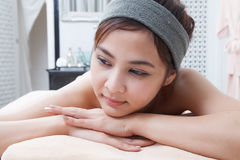 Asian girl in spa. Beautiful asian girl in spa on spa bed Stock Photos