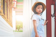 Asian girl standing on the balcony terrace royalty free stock photography