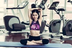 Asian girl stretches muscle by pretending yoga in a fitness.vint. Asian girl model Prepare to exercise in the fitness Stock Photo