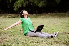 Asian girl stretches in the park Royalty Free Stock Photos