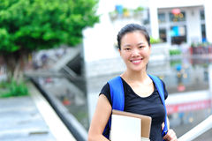 Asian girl student in campus. Asian girl student happy smiling in campus Stock Image