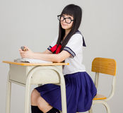 Asian girl student in school uniform with book Stock Photo