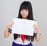 Asian girl student in school uniform with book Royalty Free Stock Photos