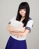 Asian girl student in school uniform with book Royalty Free Stock Images