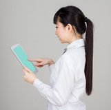 Asian girl student in school uniform click pad Stock Images