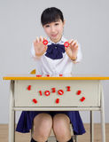 Asian girl student in school uniform math Stock Image