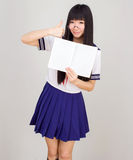 Asian girl student in school uniform  with Open book Royalty Free Stock Photo