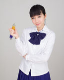 Asian girl student in school uniform studying with an oversize ball pen Royalty Free Stock Photo