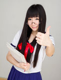 Asian girl student in school uniform thumb up Stock Photos