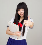 Asian girl student in school uniform thumb up Royalty Free Stock Image