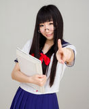 Asian girl student in school uniform touch screen Royalty Free Stock Photo