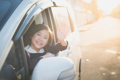 Asian girl in student uniform going to school by ca. R and  waving goodbye Stock Photos