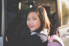 Asian girl in student uniform going to school by car. Under sunlight Stock Photos
