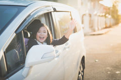 Asian girl in student uniform going to school by car. And  waving goodbye Stock Photo