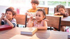 Asian girl studying in kindergarten classroom stock photo
