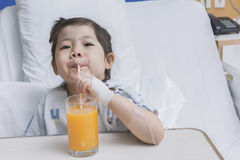 Asian girl While sucking orange juice to nourish the body. Stock Image