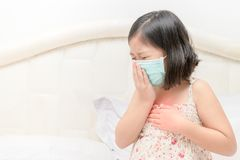 Asian girl suffer from cough with face mask protection. Virus protection concept Stock Photos