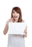 Asian girl surprise with  blank sign in hand Royalty Free Stock Photography