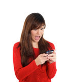 Asian girl surprised with mobile phone Stock Photography