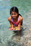 Asian girl swimming Royalty Free Stock Photos