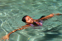 Asian girl swimming Royalty Free Stock Image