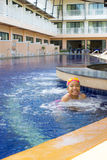 Asian girl in swimming pool Stock Photo