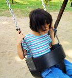 Asian girl on swing Royalty Free Stock Photos