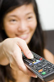 Asian girl switching channels Stock Photography